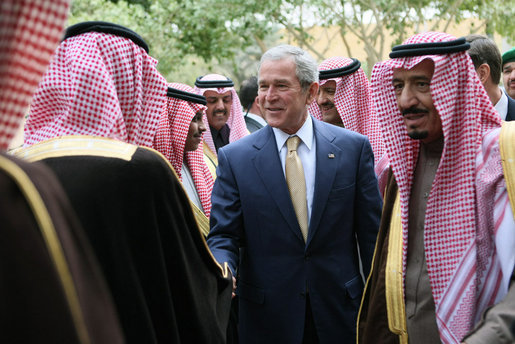 Accompanied by Prince Salman bin Abdul Al-Aziz, right, President George W. Bush greets officials as he arrives Tuesday, Jan. 15, 2008, at Al Murabba Palace in Riyadh. White House photo by Eric Draper