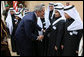 President George W. Bush greets school children during his visit Tuesday, Jan. 15, 2008, to Al Murabba Palace in Riyadh. The President is spending his last day in Saudi Arabia before continuing on to Egypt en route home to Washington, D.C. White House photo by Eric Draper