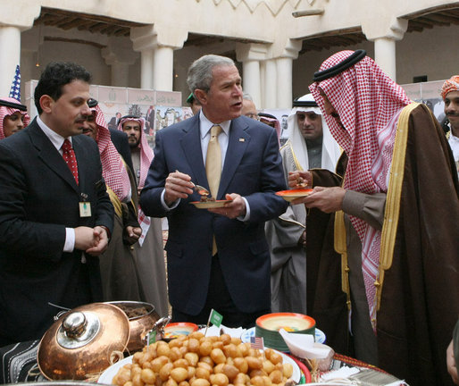President George W. Bush and Prince Salman bin Abdul Al-Aziz, right, taste a vendor's offering Tuesday, Jan. 15, 2008, as they visited Al Murabba Palace and National History Museum in Riyadh. White House photo by Eric Draper