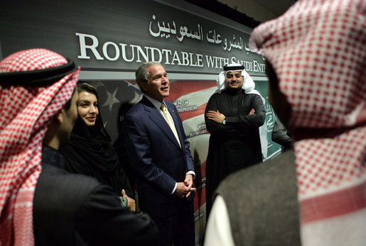 "Participants in a roundtable discussion with President George W. Bush talk with him afterwards Tuesday, Jan. 15, 2008, at the U. S. Embassy in Riyadh. The President told the entrepreneurs, ""I love the fact that some of you were educated in America. I think you'll find you got a good education there, but more importantly, Americans get to see you, and you get to see them. And the best way to achieve better understanding in the world is for folks just to get together, and get to understand that we share the same God, and we share the same aspirations for children and for our futures."" White House photo by Chris Greenberg"