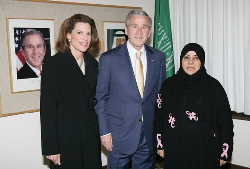 U.S. Ambassador of Protocol Nancy Brinker and President George W. Bush stand with Dr. Samia Al-Amoudi, a breast cancer survivor, after a roundtable discussion with Saudi entrepreneurs Tuesday, Jan. 15, 2008, during the President's visit to Riyadh. White House photo by Chris Greenberg
