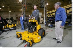 "As Bill Wright, Founder and Chief Executive Officer of Wright Manufacturing, Inc., looks on, President George W. Bush stands on a ""Stander"" lawn mower in its final testing stage Friday, Jan. 18, 2008, during his visit to the Frederick, Maryland facility. Said the President during the visit, ""Let me tell you why I'm here. This man started his own business. He's a manufacturer, he employs over a hundred people, and he represents the backbone of the American economy. And today I talked about our economy, and the fundamentals are strong, but there's uncertainty. And there's an opportunity to work with Congress to pass a pro-growth package that will deal with the uncertainty."" White House photo by Joyce N. Boghosian"