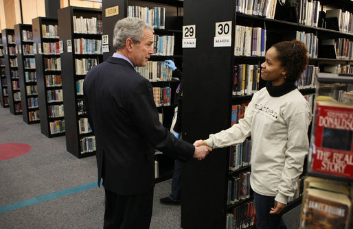 President George W. Bush speaks with a volunteer, thanking her for her service, during a visit to the Martin Luther King, Jr., Memorial Library Monday, Jan. 21, 2008 in Washington, D.C., to commemorate Martin Luther King, Jr., Day. White House photo by Eric Draper