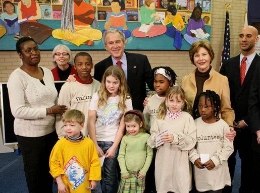 President George W. Bush and Laura Bush are joined by Washington, D.C. Mayor Adrian Fenty, right, and Ginnie Cooper, Chief Librarian for the Washington, D.C. libraries, left, posing for photos with children and staff at a reading class commemorating Martin Luther King, Jr., Day Monday, Jan. 21, 2008, at the Martin Luther King, Jr., Memorial Library. White House photo by Eric Draper