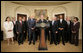 President George W. Bush is flanked by members of his Advisory Council on Financial Literacy Tuesday, Jan. 22, 2008, as he announces its establishment during a statement in the Roosevelt Room of the White House. White House photo by Shealah Craighead