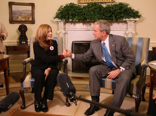 President George W. Bush holds the hand of Elsa Morejon, wife of Presidential Medal of Freedom recipient and human rights activist Oscar Biscet, who is currently being held in a Cuban prison, during a meeting welcoming Morejon to the Oval Office, Thursday, Jan. 24, 2008. White House photo by Eric Draper