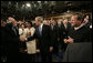 President George W. Bush shakes the hand of Secretary of Treasury Henry Paulson as he arrives on the House floor at the U.S. Capitol Monday, Jan. 28, 2008, to deliver his 2008 State of the Union address. Looking on are Secretary of State Condoleezza Rice and U.S. Supreme Court Chief Justice John Roberts. White House photo by Eric Draper