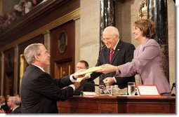 President George W. Bush delivers copies of his speech to Speaker of the House Nancy Pelosi (D-California) and Vice President Dick Cheney before delivering his 2008 State of the Union address Monday, Jan. 28, 2008, at the U.S. Capitol. White House photo by Eric Draper