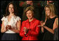 Mrs. Laura Bush, joined by her daughters, Barbara, left, and Jenna applaud from the First Lady's box at the U.S. Capitol, as President George W. Bush delivers his State of the Union Address Monday, Jan. 28, 2008. White House photo by Joyce N. Boghosian