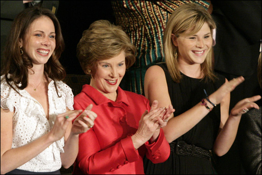 Mrs. Laura Bush and her daughters, Barbara, left, and Jenna applaud from the First Lady's box at the U.S. Capitol, as President George W. Bush delivers his State of the Union Address Monday, Jan. 28, 2008. White House photo by Shealah Craighead