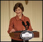 "Mrs. Laura Bush speaks to the audience Monday, Jan. 28, 2008, during the President's Committee on the Arts and the Humanities Coming Up Taller awards ceremony in the East Room of the White House. Mrs. Bush told her audience, ""The Coming Up Taller award winners have made a demonstrable impact on the lives of children, many of whom need extra attention from caring adults to help them stay on track for a healthy and successful life."" White House photo by Shealah Craighead"