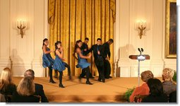 Ritmo en Accion, from Jamaica Plain, Massachusetts, performs during the Coming Up Taller awards ceremony Monday, Jan. 28, 2008, in the East Room of the White House. The youth dance initiative was created in 2001 by the Hyde Square Task Force to combat high crime, violence and low student achievement in its tough, inner-city Boston neighborhood.  White House photo by Shealah Craighead