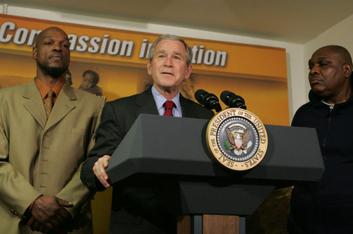 "President George W. Bush stands next to graduates Adolphus Mosely, left, and Thomas Boyd, as he delivers remarks after visit the faith-based Jericho Program Tuesday, Jan. 29, 2008, in Baltimore. Said the President, ""I've come to look firsthand at the Jericho Program, which is helping former prisoners make a successful transition back to society. There's no more important goal than to help good souls become -- come back to our society as productive citizens. I'm honored to have been with those who have worked hard to deal with their circumstances in such a way that they become productive citizens. I'm standing next to two such men, and I met probably seven others downstairs."" White House photo by Joyce N. Boghosian"