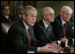 President George W. Bush, joined by Deputy Secretary of Defense Gordon England, center, and Deputy National Security Advisor James Jeffrey, right, talks to reporters Tuesday, Jan. 29, 2008, during a meeting in the Cabinet Room of the White House with the Joint Chiefs and Combatant Commanders. White House photo by Eric Draper