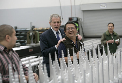 President George W. Bush speaks with assembly workers on his tour of the Robinson Helicopter Company Wednesday, Jan. 30, 2008 in Torrance, Calif. White House photo by Eric Draper