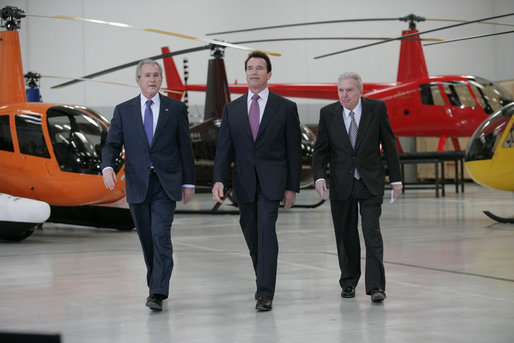 President George W. Bush tours the Robinson Helicopter Company Wednesday, Jan. 30, 2008 in Torrance, Calif., joined by California Governor Arnold Schwarzenegger and CEO Frank Robinson. Following the tour President Bush addressed employees and members of the media on the nation's economy and the importance of free trade agreements. White House photo by Eric Draper
