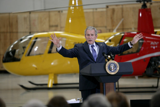 President George W. Bush gestures as he addresses his remarks on the economy and the benefits of free trade, following his tour of the Robinson Helicopter Company Wednesday, Jan. 30, 2008 in Torrance, Calif. White House photo by Eric Draper