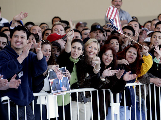 Employees at the Robinson Helicopter Company cheer President George W. Bush, Wednesday, Jan. 30, 2008 in the Torrance, Calif., where President Bush toured the facility and spoke about the nation's economy and the importance of free trade agreements. White House photo by Eric Draper