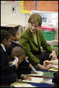 Mrs. Laura Bush visits a kindergarten classroom and participates in a reading lesson Wednesday, Jan. 30, 2008, at Holy Redeemer School in Washington, D.C. White House photo by Shealah Craighead