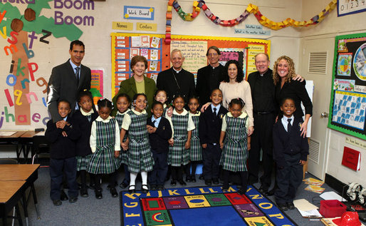 Mrs. Laura Bush accompanied by Archbishop of Washington, D.C.Donald W. Wuerl, pose for a photo with staff and students of Holy Redeemer School Wednesday, Jan. 30.2008, in Washington, D.C. White House photo by Shealah Craighead