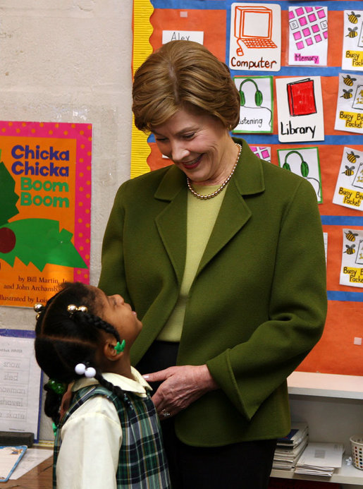 Mrs. Laura Bush listens to a kindergarten student during her visit at Holy Redeemer School Wednesday, Jan. 30. 2008. White House photo by Shealah Craighead