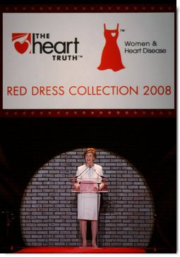 Mrs. Laura Bush addreses guests and participants at The Heart Truth Red Dress Collection 2008 fashion show in New York, Friday, Feb. 1, 2008. More than 20 celebrated women joined Mrs. Bush and America's top designers to show one-of-a-kind Red Dresses and raise awareness of heart disease in women. White House photo by Shealah Craighead