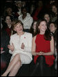 Mrs. Laura Bush, accompanied by daughter, Barbara Bush, watch fashion models during The Heart Truth Red Dress Collection 2008 fashion show in New York, Friday, Feb. 1, 2008. More than a dozen celebrated women showcased America's top designers in one-of-a-kind Red Dresses to raise awareness of heart disease in women. White House photo by Shealah Craighead