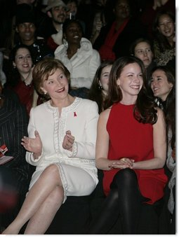 Mrs. Laura Bush, accompanied by daughter, Barbara Bush, watch fashion models during The Heart Truth Red Dress Collection 2008 fashion show in New York, Friday, Feb. 1, 2008. More than 20 celebrated women joined Mrs. Bush and America's top designers to show one-of-a-kind Red Dresses and raise awareness of heart disease in women. White House photo by Shealah Craighead