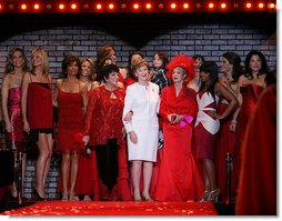 Mrs. Laura Bush is joined by singer/actress Liza Minnelli, left, her fellow actresses, and fashion models participating in The Heart Truth Red Dress Collection 2008 fashion show in New York, Friday, Feb. 1, 2008. Heart Truth is a national awareness campaign that warns women of the dangers of heart disease. White House photo by Shealah Craighead