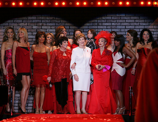 Mrs. Laura Bush is joined by singer/actress Liza Minnelli, left, her fellow celebrities, and fashion models participating in The Heart Truth Red Dress Collection 2008 fashion show in New York, Friday, Feb. 1, 2008. Heart Truth is a national awareness campaign that warns women of the dangers of heart disease. White House photo by Shealah Craighead
