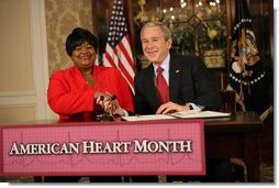 "President George W. Bush shakes the hand of Joyce Cullen, a heart disease survivor, after signing the Presidential Proclamation in Honor of American Heart Month Friday, Feb. 1, 2008, in Kansas City, Mo. In signing the proclamation, the President thanked Mrs. Cullen for her work and said, "".She's very much a part of the Heart Truth Campaign here in Kansas City. And she's helping people understand two things -- one, be able to recognize the symptoms, and secondly, be able to prevent the symptoms from happening in the first place. So I want to thank you for being a strong leader in the campaign for awareness.""  White House photo by Eric Draper"