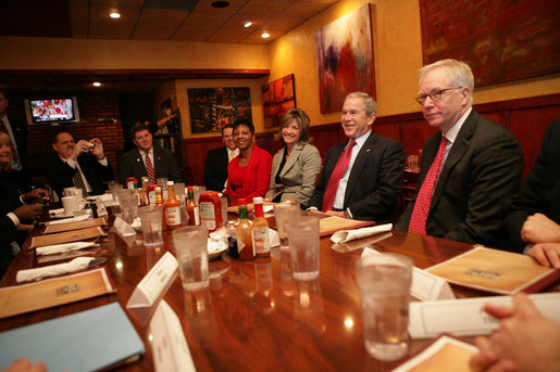 President George W. Bush meets with local business leaders at breakfast Friday, Feb. 1, 2008, in Kansas City, Mo. The President met the group before continuing on to Hallmark Cards, Inc., where he delivered a statement on the economy. White House photo by Eric Draper