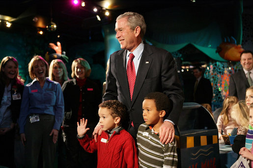 President George W. Bush pauses to talk Friday, Feb. 1, 2008, with Eli Lockhart, left, and Alex Harris, both 6 years old, at the Kaleidoscope Creative Center at Hallmark Cards, Inc., in Kansas City, Mo. White House photo by Eric Draper