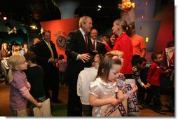 President George W. Bush is greeted upon arrival at Hallmark Cards, Inc., in Kansas City, Mo., Friday, Feb. 1, 2008, where he delivered a statement on the economy. White House photo by Eric Draper