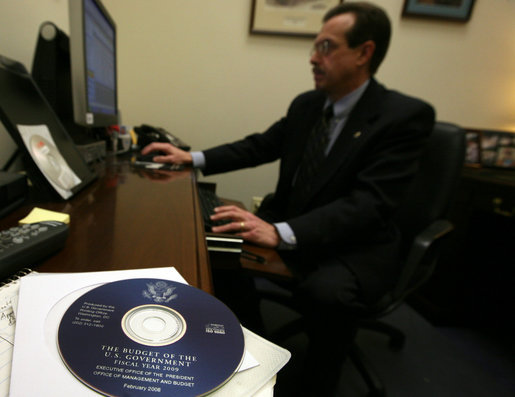 The Executive Clerk of the White House electronically transmits the FY2009 Budget Monday, Feb. 4, 2008, marking the first time in American history that the Executive Branch has electronically transmitted a budget proposal, or any official government document, to the Legislative Branch. The Executive Clerk used an approved credential to digitally sign the electronic transmittal of the FY09 Budget, thus proving the document's authenticity. White House photo by Joyce N. Boghosian