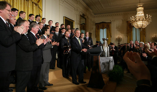 President George W. Bush welcomes the 2007 NHL Stanley Cup champion Anaheim Ducks to the East Room of the White House Wednesday, Feb. 6, 2008. The Ducks claimed their first Cup when they defeated the Ottawa Senators in the best-of-seven championship series in June 2007. White House photo by Chris Greenberg