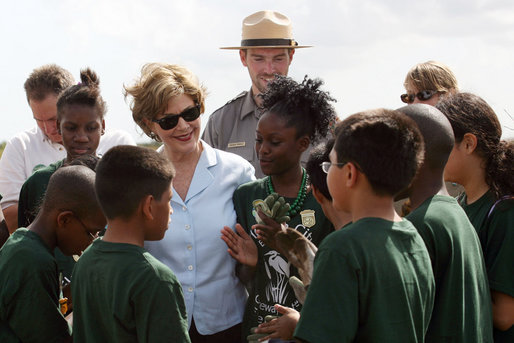 "Mrs. Laura Bush visits with Florida City Elementary School students Wednesday, Feb. 6, 2008, during the Junior Ranger ""First Bloom"" planting event in Everglades National Park, Fla. President Bush on Monday asked Congress to spend $215 million for restoration of the Everglades. White House photo by Shealah Craighead"