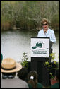 "Mrs. Laura Bush addresses students and guests Wednesday, Feb. 6, 2008, during the Junior Ranger ""First Bloom"" planting event in Everglades National Park, Florida, praising a program to help bring back native trees in areas of the Everglades overgrown with non-native plants. White House photo by Shealah Craighead"