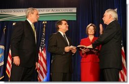 President George W. Bush listens as the Oath of Office is administered ceremoniously by Deputy Secretary Chuck Conner to U.S. Department of Agriculture Secretary Ed Schafer Wednesday, Feb. 6, 2008. Holding the Bible is Nancy Schafer, wife of the new secretary.  White House photo by Chris Greenberg