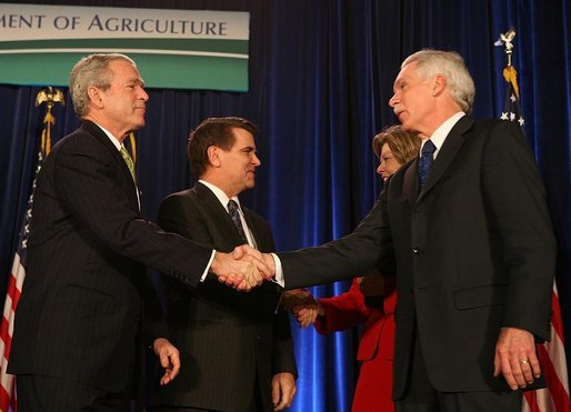 President George W. Bush congratulates Secretary of Agriculture Ed Schafer after he was ceremoniously sworn in Wednesday, Feb. 6, 2008, at the U.S. Department of Agriculture. In the background are Mrs. Nancy Schafer and Deputy Secretary Chuck Conner. White House photo by Chris Greenberg