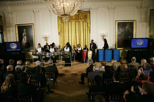 President George W. Bush and Mrs. Laura Bush watch as the St. Veronicas Youth Steel Orchestra performs at the Helping America's Youth Event Thursday Feb. 7, 2008, in the East Room of the White House. White House photo by Shealah Craighead