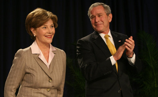 President George W. Bush smiles as Mrs. Laura Bush is introduced Thursday, Feb. 7, 2008, during the National Prayer Breakfast at the Washington Hilton Hotel. White House photo by Joyce N. Boghosian