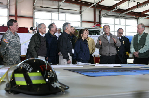 President George W. Bush attends a briefing on regional tornado damage shortly after arriving Friday, Feb. 8, 2008, at the Lafayette Fire Department in Lafayette, Tennessee. The President visited the area in the wake of Tuesday's deadly tornadoes. White House photo by Chris Greenberg
