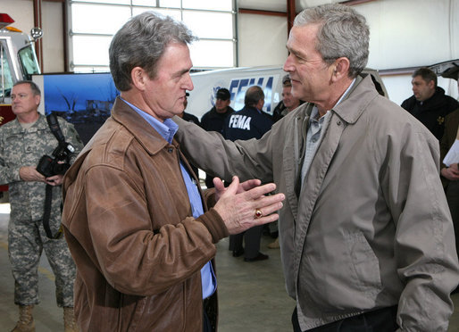 President George W. Bush spends a moment with Shelvy Linville, Mayor of Macon County, Tennessee, after attending a briefing Friday, Feb. 8, 2008, on the regional tornado damage left in the wake of Tuesday's deadly storms. White House photo by Chris Greenberg