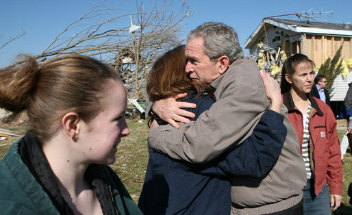 President George W. Bush comforts a resident of Lafayette, Tennessee during his tour Friday, Feb. 8, 2008, of the destruction left in the wake of Tuesday's deadly tornadoes. White House photo by Chris Greenberg