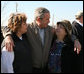 President George W. Bush embraces residents of Lafayette, Tennessee during his visit Friday, Feb. 8, 2008, to the region that was hard hit by Tuesday's tornadoes. White House photo by Chris Greenberg