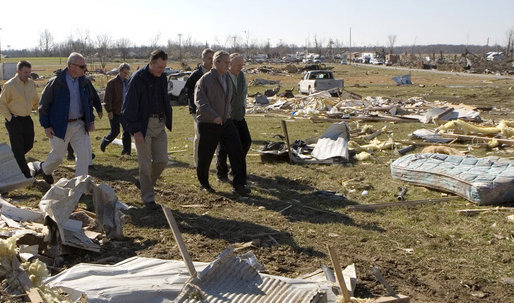 President George W. Bush walks a rubble-strewn stretch of highway in Lafayette, Tennessee Friday, Feb. 8, 2008, during his visit to the region that was hard hit by tornadoes earlier in the week. White House photo by Chris Greenberg