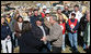 "President George W. Bush holds the hands of Phil and June Spears after touring their Lafayette, Tennessee neighborhood Friday, Feb. 8, 2008. The President assured the Spears that they'd receive the care they needed in the wake of Tuesday's deadly tornadoes, and said, ""And you're going to find you got some new friends showing up, too. When they know there's a neighbor in need, they'll come and help you."" White House photo by Chris Greenberg"