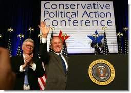 President George W. Bush acknowledges the audience after delivering remarks Friday, Feb. 8, 2008, to the 35th Conservative Political Action Conference in Washington, D.C. With him is Dave Keene, Chairman of the American Conservative Union. White House photo by Joyce N. Boghosian