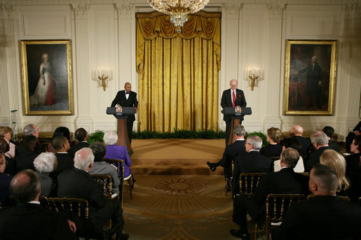 President George W. Bush and First Lady Laura Bush listen as Actor Avery Brooks, (L), and Dr. Allen Guelzo make remarks during a ceremony in the East Room of the White House honoring Abraham Lincoln's 199th Birthday, Sunday, Feb. 10, 2008. White House photo by Chris Greenberg
